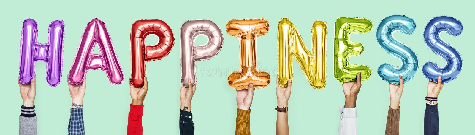 Colorful alphabet balloons forming the word happiness royalty free stock photos