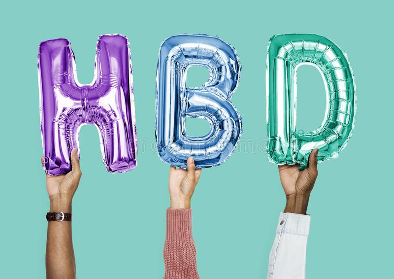 Colorful alphabet balloons forming the word HBD stock photos