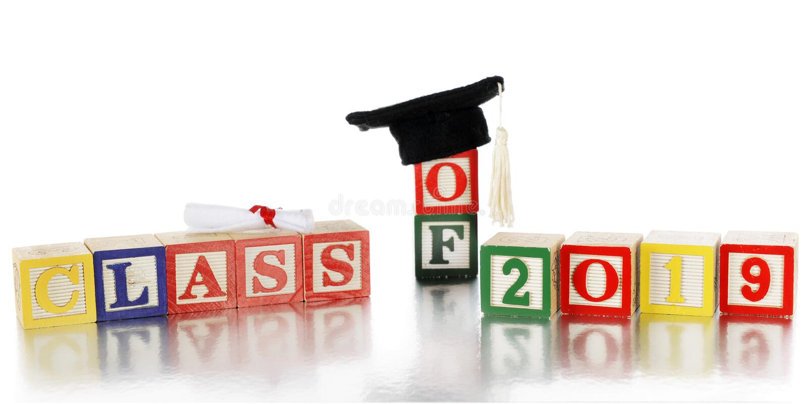 Class of 2019. Colorful alphabet blocks arranged to say `Class of 2019,` topped with a mini graduation hat and rolled up diploma. On a white background with the royalty free stock photo