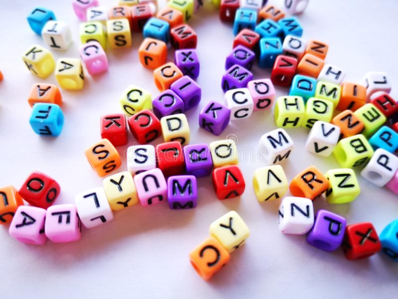 Colorful alphabet blocks with white background. stock images