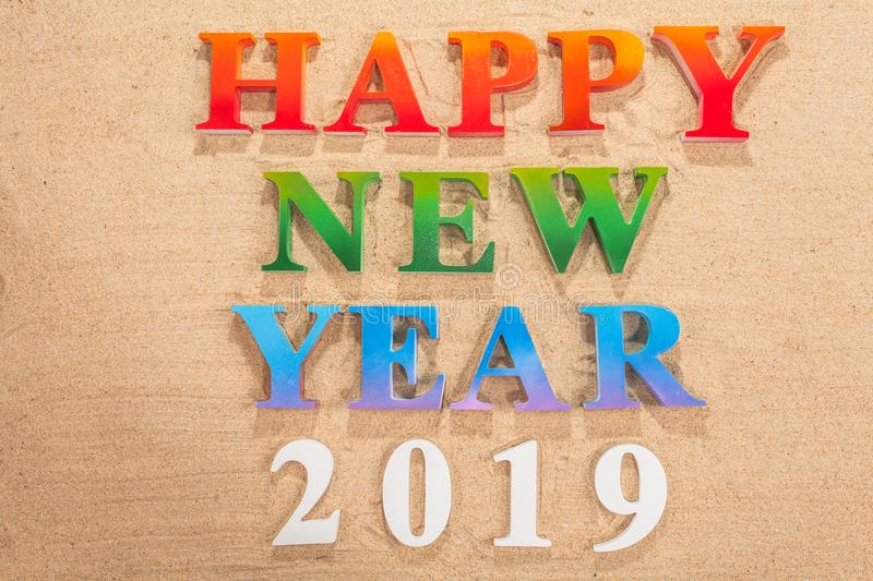 Colorful of alphabet happy new year 2019 on the beach. Decorate with shells with copy space stock image