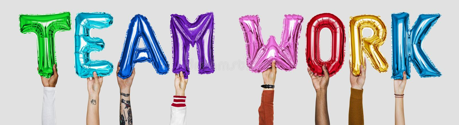 Colorful alphabet helium balloons forming the text teamwork stock photos