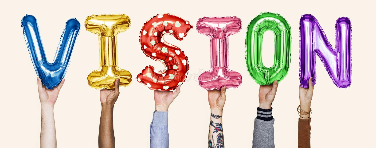 Colorful alphabet helium balloons forming the text vision royalty free stock photography