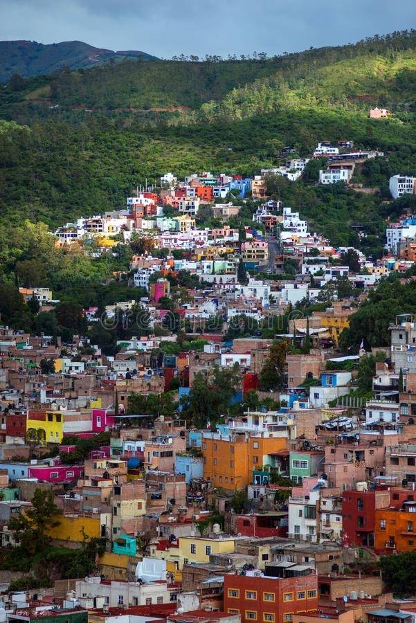Colorful ancient american city architecture in hill, Mexico. Colorful colonial architecture city in hill, which was built in silver mining age, with crowd royalty free stock photo