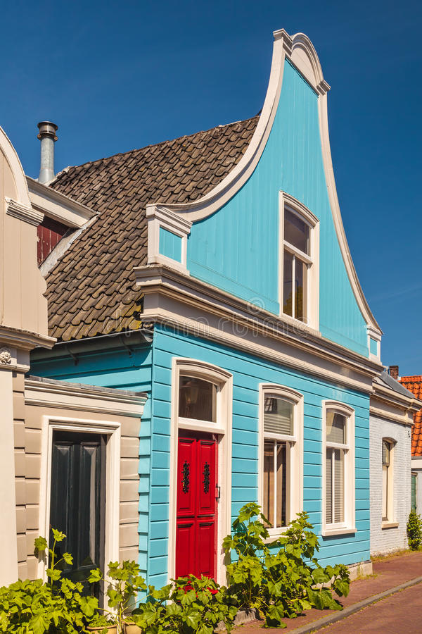 Colorful ancient blue wooden house in The Netherlands. Against a clear blue sky royalty free stock images