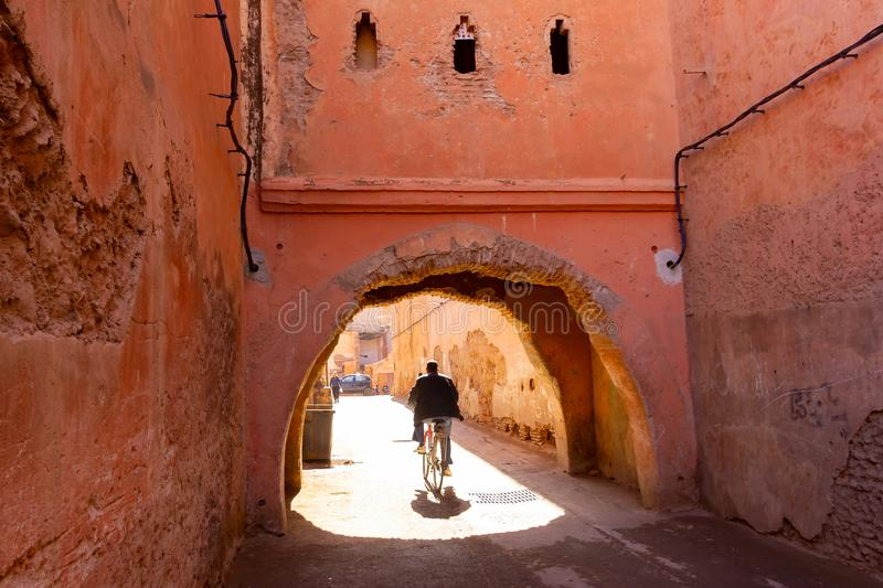 Colorful ancient old and narrow street in medina of Marrakech, Morocco, Africa stock image