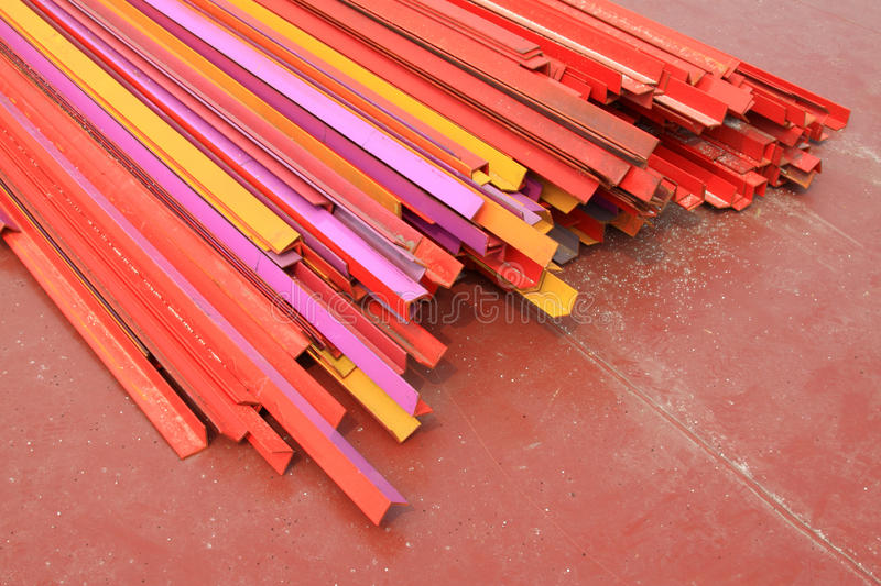Colorful angle steel. Piling up together color angle steel in a factory in china royalty free stock photography