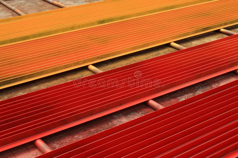 Colorful angle steel. Piling up together color angle steel in a factory in china stock photography