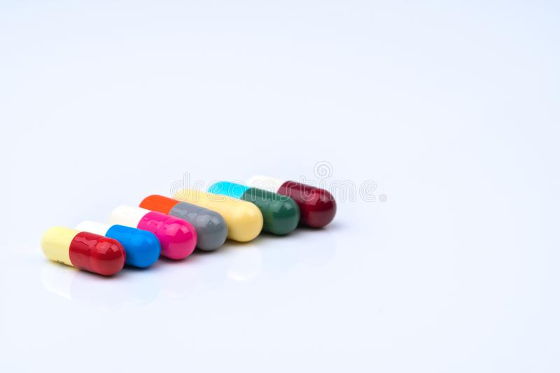 Colorful of antibiotic capsules pills in a row on white background with copy space. royalty free stock photo