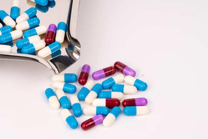 Colorful antibiotic capsules on stainless steel drug tray stock images