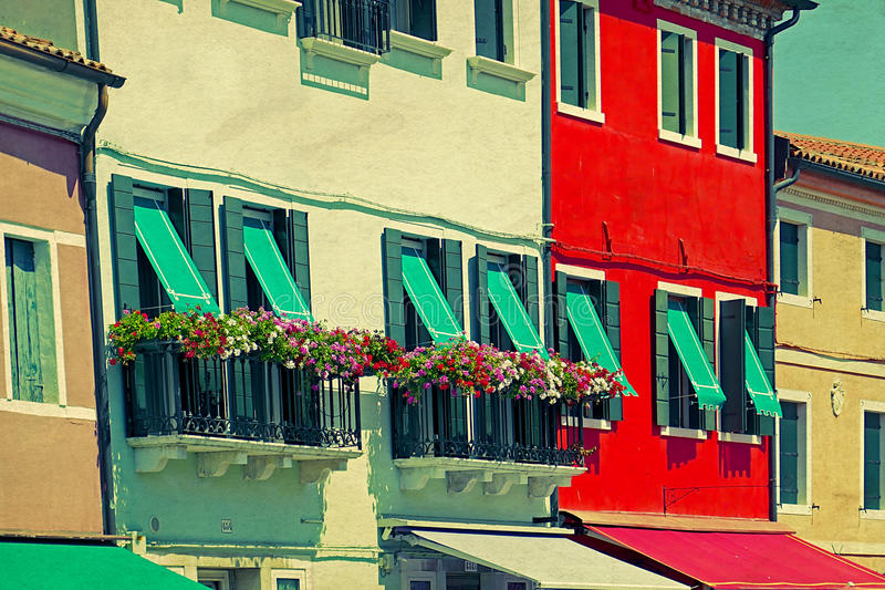 Colorful apartment building in Burano, Italy. An island with colorful architecture in the Venetian Lagoon. Vintage processing royalty free stock images