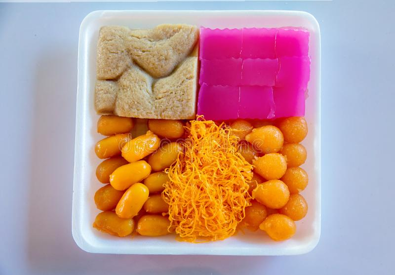 Colorful appearance and distinct flavors. The art of Thai desserts have been passed down through the generations. Colorful of Thai steamed layer cake in cube stock images