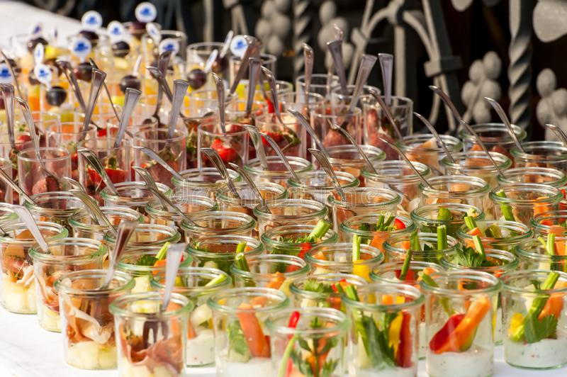 Colorful appetizers in small glasses in rows stock image