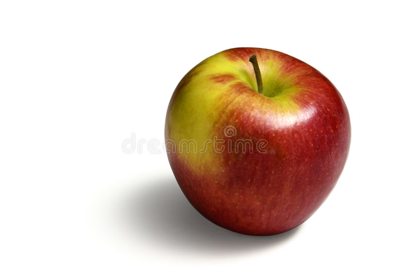 Colorful Apple. A pinata apple isolated on a white background royalty free stock image