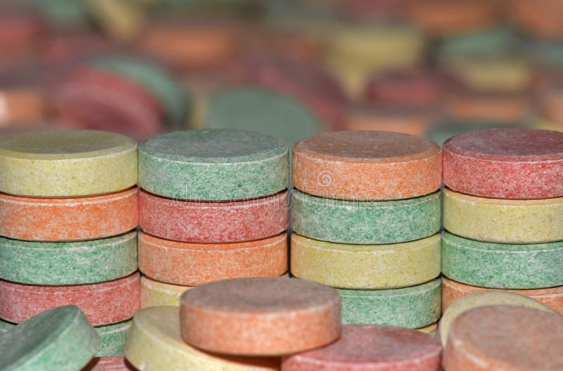 A colorful array of common antacid pills. stock image