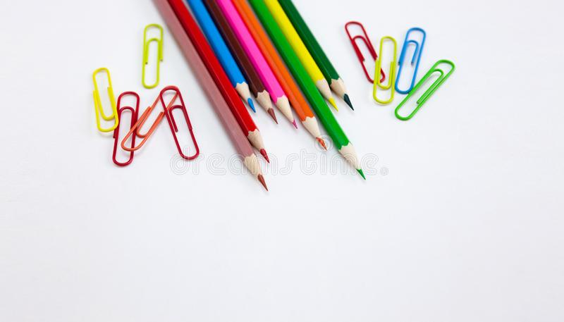 Colorful art and drawing concepts, Crayon pencils and clips on white background. Colorful art and drawing concepts, Crayon pencils and clips at top corner on stock image