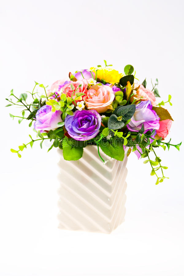 Colorful artificial beautiful flowers in a vase stock photography