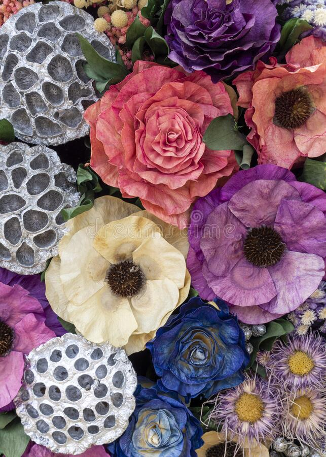 colorful of artificial flowers, colorful flowers bouquet, colorful of the plastic and fabric flowers. Dried flowers stock image