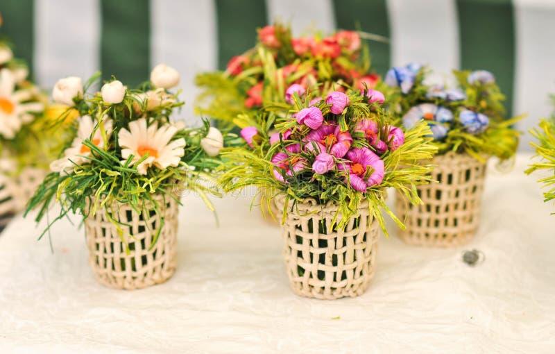 Colorful artificial flowers decorations. Decorative arrangement of various flowers at Romanian market stock photography