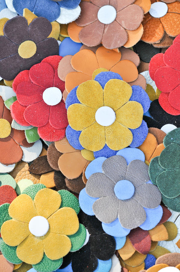 Colorful artificial flowers decorations. Decorative arrangement of various flowers at Romanian market. Colorful textile flowers. As background royalty free stock photo