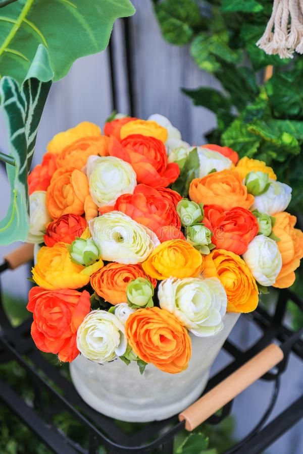 A colorful artificial flowers in a white pot on black metal shel download a colorful artificial flowers in a white pot on black metal shel stock image mightylinksfo