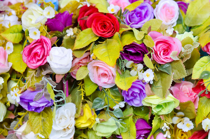 Colorful artificial roses flowers stock photos