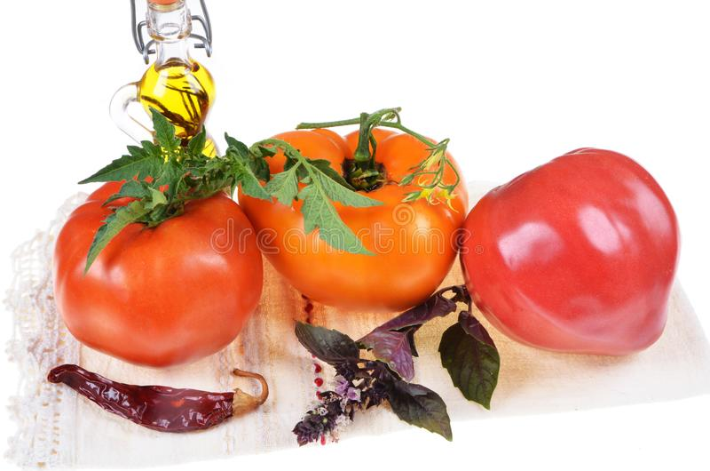 Colorful assortment of fresh  tomatoes ,basil,olive oil royalty free stock image