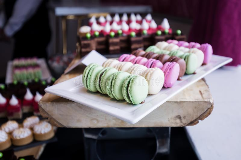 Colorful Assortment of Macarons on a Dessert Table stock photo
