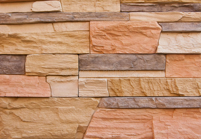 Colorful assortment of stones on wall stock photos