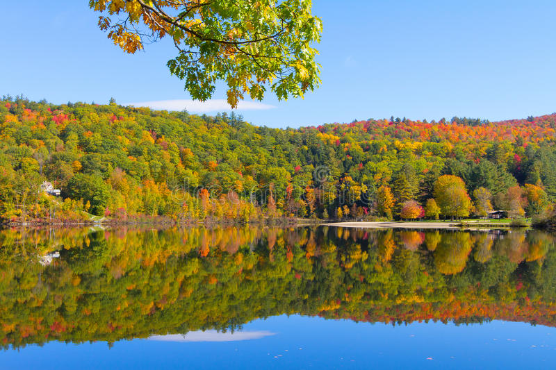 Colorful autumn foliage by lake side in vermont royalty free stock photos