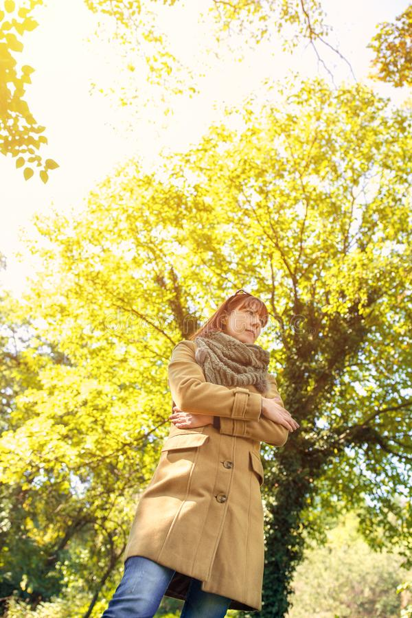 Colorful autumn forest. portrait of ginger girl at beautiful autumn forest royalty free stock images