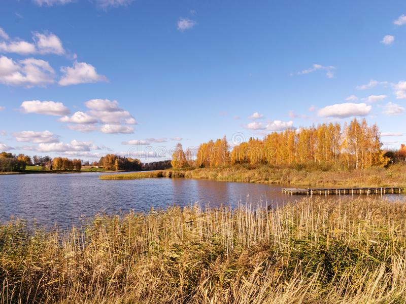 Autumn landscape by the lake, golden autumn, colorful trees and reflections royalty free stock images