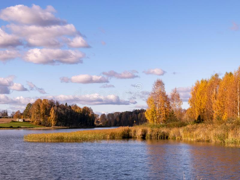 Autumn landscape by the lake, golden autumn, colorful trees and reflections stock images
