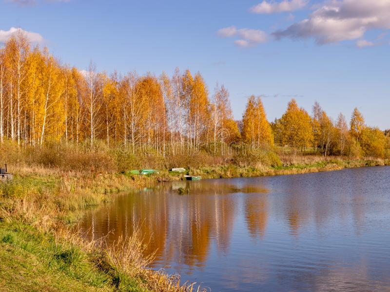 Autumn landscape by the lake, golden autumn, colorful trees and reflections stock photos