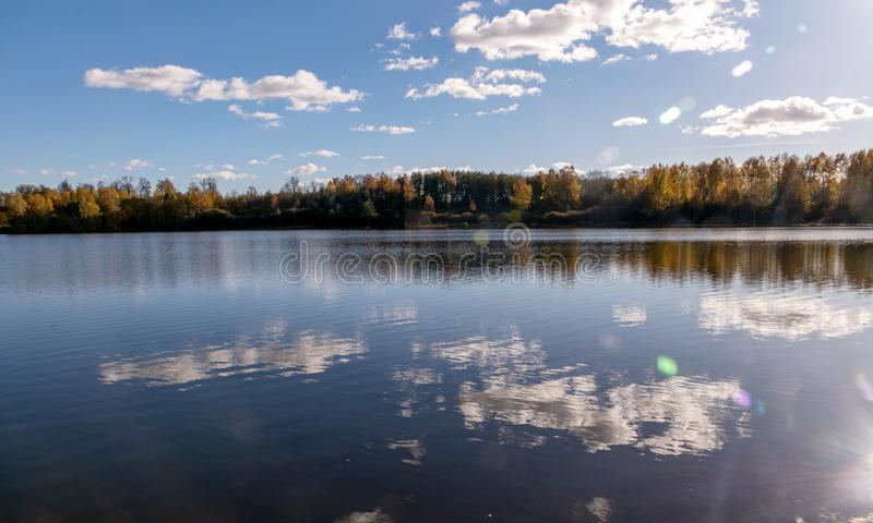 Autumn landscape by the lake, golden autumn, colorful trees and reflections royalty free stock photo