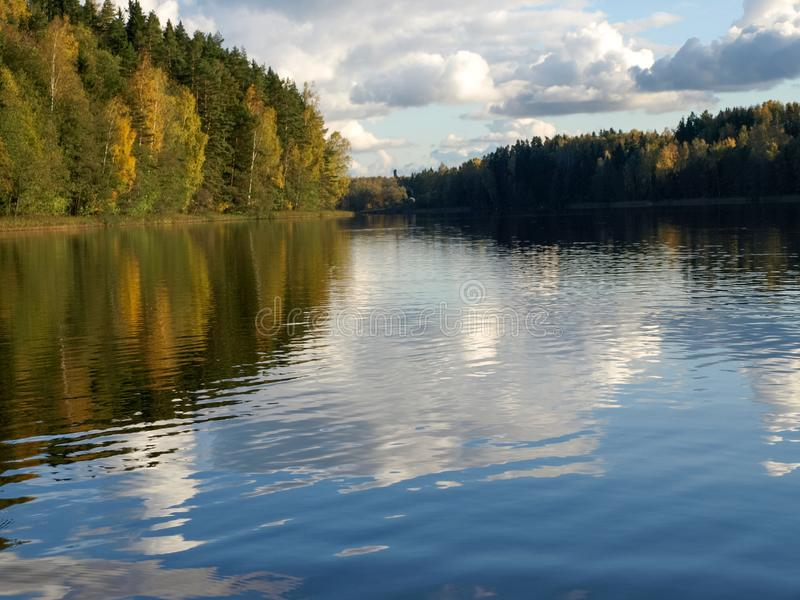 Autumn landscape with lake and gorgeous trees, beautiful reflections in calm water royalty free stock photo