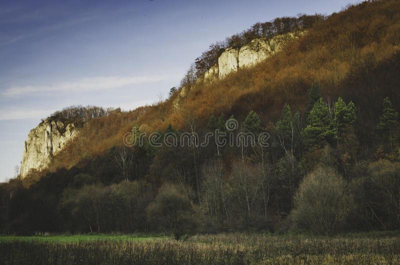 Colorful autumn landscape in the valley. With rocks royalty free stock images