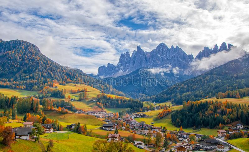 Colorful autumn scenery in Santa Maddalena village at sunny day. Dolomite Alps, South Tyrol, Italy royalty free stock photography