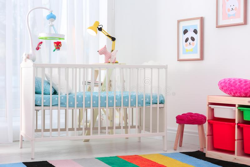 Colorful baby room interior with crib. Colorful baby room interior with comfortable crib stock photo