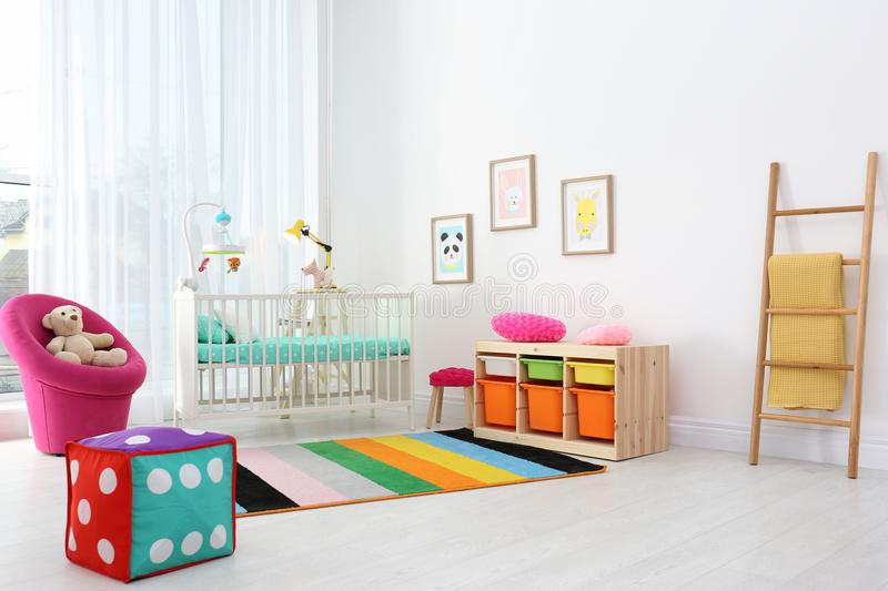Colorful baby room interior with crib. Colorful baby room interior with comfortable crib royalty free stock photos