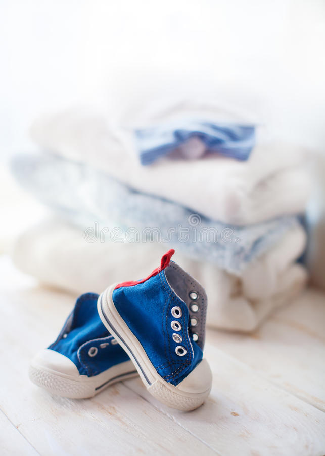 Colorful baby sneakers on white background stock photography