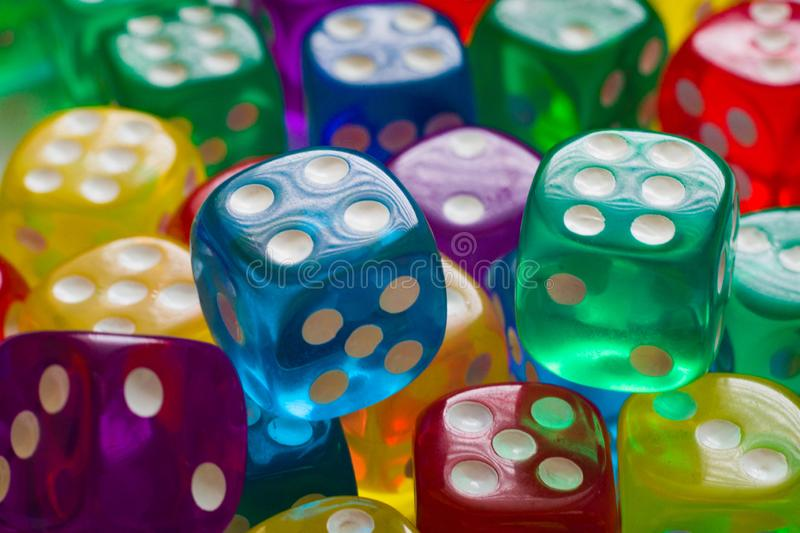 Colorful background with blue, yellow, green and purple dice stock photo