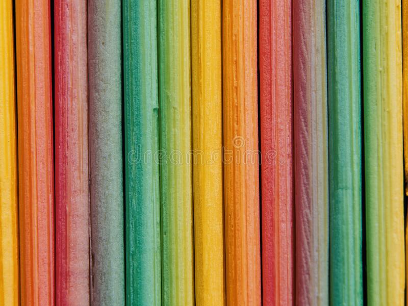 Colorful background created from pieces of wood. close-up small boards stock photography