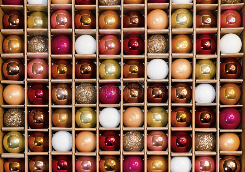 Colorful Background Grid Pattern of Glass Holiday Decoration Balls. Box of colorful holiday decorative glass balls creates a background grid pattern in a box stock images