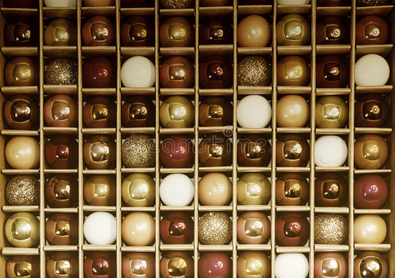 Colorful Background Grid Pattern of Vintage Glass Holiday Decoration Balls. Box of vintage colorful holiday decorative glass balls creates a background grid royalty free stock photography