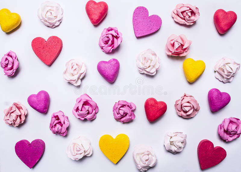Colorful background of hearts and paper roses on a white wooden background Valentine's Day stock image