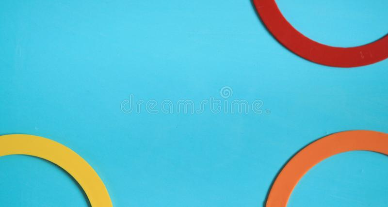 Colorful background with kids round toys royalty free stock photography