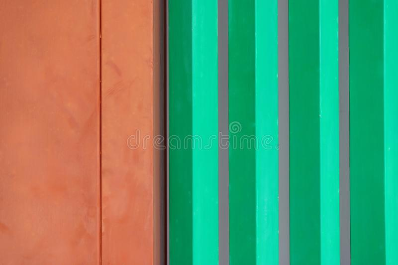 Colorful background of the orange wooden door and edge door and  green wooden windowst outside the building, according to Japanese. Colorful background of the royalty free stock photography
