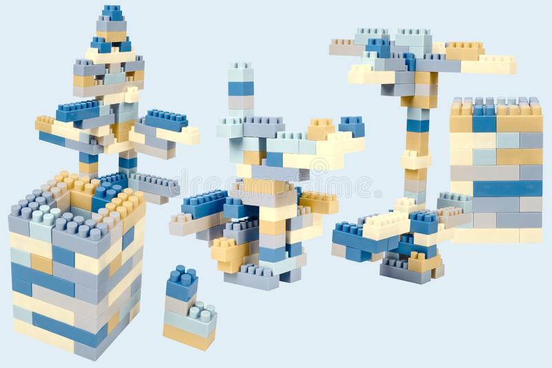 Plastic blocks kit in beige and blue tones. royalty free stock photography