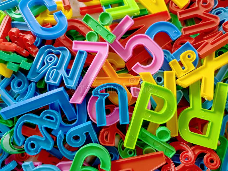 Colorful Background of Plastic Numbers with English and Thai Alphabets royalty free stock image